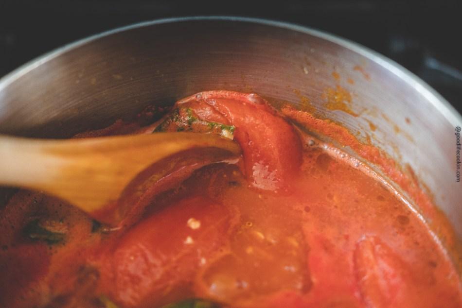 mashing tomatoes