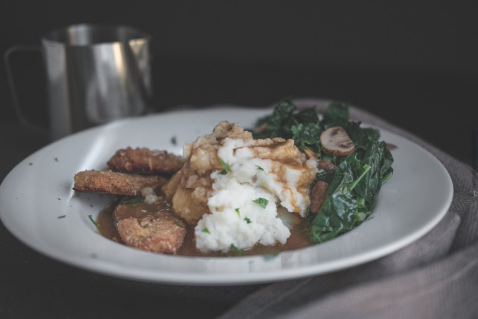 Mashed potatoes and crispy tenders with kale
