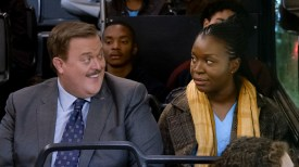 """Pilot"" -- After having a heart attack, a middle-aged sock businessman from Detroit unexpectedly falls for his cardiac nurse, a Nigerian immigrant, and sets his sights on getting her to give him a chance in the CBS pilot BOB ❤ ABISHOLA. Pictured (L-R): Billy Gardell as Bob and Folake Olowofoyeku as Abishola. Photo: Best Possible Screen Grab/CBS ©2019 CBS Broadcasting, Inc. All Rights Reserved"