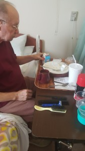 Dad eating lunch. Note the handy grooming tools always at hand.