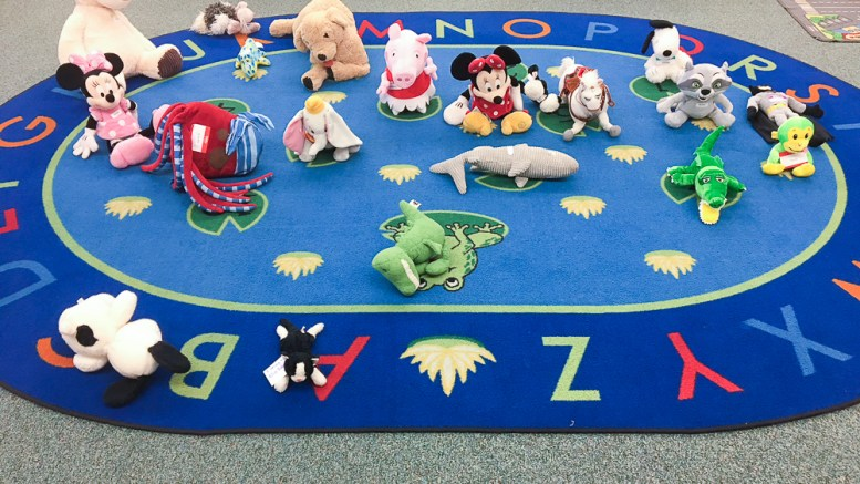 Students' stuffed animals in their classroom at school.