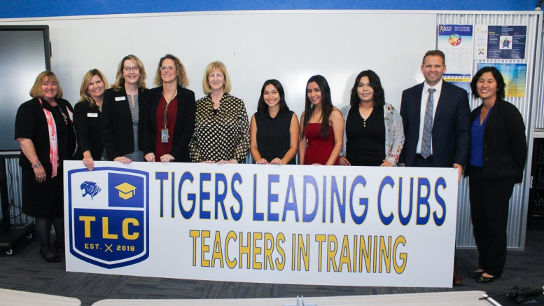 Pictured from left to right is Candy Plahy, Terri Giamarino, Linda Skipper, Amy Jensen, Diana McKibben, students Isabel Martinez, Jahaira Jimenez, Getsemani Zambrano, Keith Carmona, and Olivia Yaung.