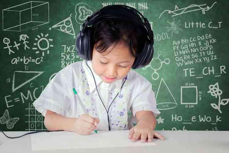 boy writing at a desk