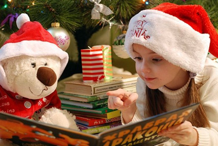 Christmas traditions, girl reading a Christmas book