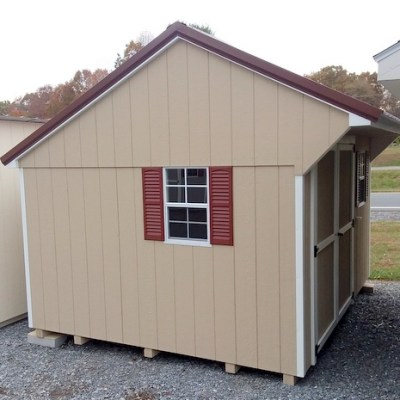 10 x 12 Painted Carriage (MO# 515) Tan Siding, White Trim, Brown Metal Roof, Redwood Shutters. 10' Workbench and L.P. Pro Struct Flooring up grade. $3,037.27