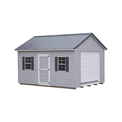 A vinyl shed with a black, metal, classic style roof. Shed has a single vinyl door and a garage door