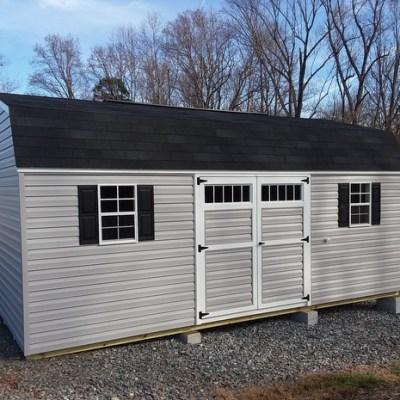 12 x 20 Vinyl High Barn (MO# 608) Flint Siding, White Trim, Black Shingles and Shutters. (2) 12' Lofts, (1) 12' Workbench, 10' Ridgevent, 6' Transom Double Doors. $4,876.33
