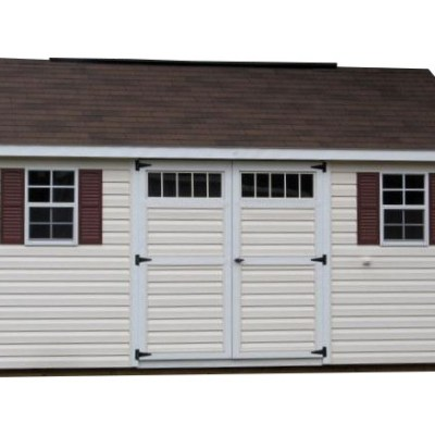 A vinyl shed with a shingled, classic style roof. Shed has a 6 foot wide set of GGS doors with transom windows, and two windows with shutters
