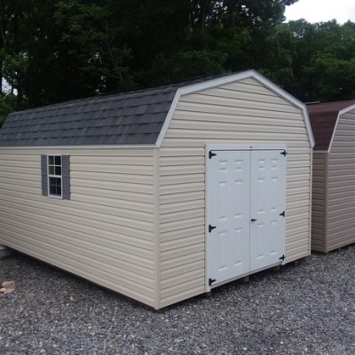 12x16 size shed, with high barn roof style, vinyl siding, shingles, and 6 foot fiberglass doors and two windows