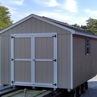 10x16 size shed, with painted L P Smart siding and a-roof style roof with shingles. Has 6 foot Good's Garden Sheds double doors on gable end with two windows one on each side wall, 10' ridge vent and 10' workbench