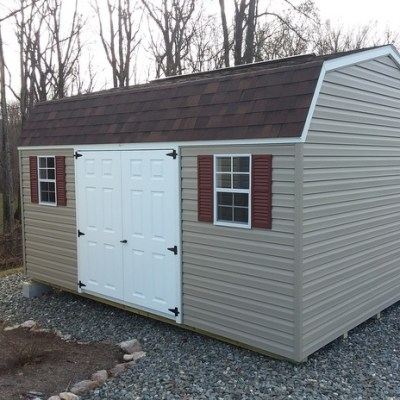 12 x 16 size vinyl high barn style shed with clay siding, white trim, brownwood architectural shingle roof, redwood shutters, 12' workbench, 12' loft, 10' ridgevent, l p pro struct flooring, 6 foot fiber doors with two windows