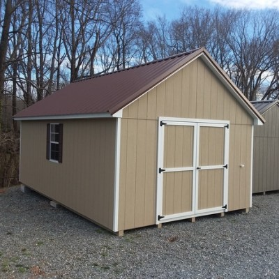 12 x 20 size painted garden style shed with tan siding, white trim, brown metal roof, brown shutters, 1 12' loft, 1 12' workbench, l p pro struct flooring, ggs 6 foot doors, two windows.