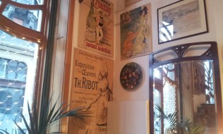 The walls with Art Nouveau advertisements