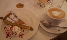 A yummy lemon cake together with a nice cappuccino
