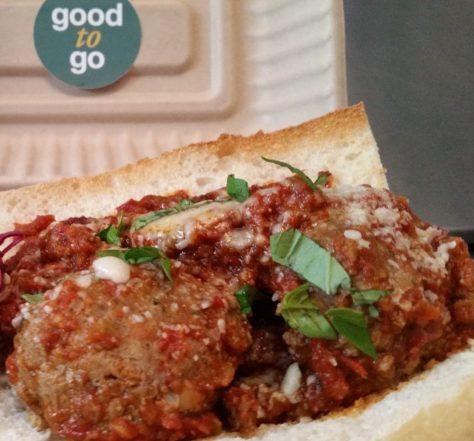 Grass-fed beef meatball sub sandwich made from ground beef from Bach Farm in Mohawk, house marinara, Italian cheeses, on a Heidelberg Baguette.