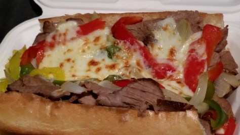 New York Cheese Steak with grass-fed, top-round roast beef* from Nectar Hills Farm, w/ peppers, onions,* Palatine provolone cheese, on a Heidelberg baguette.