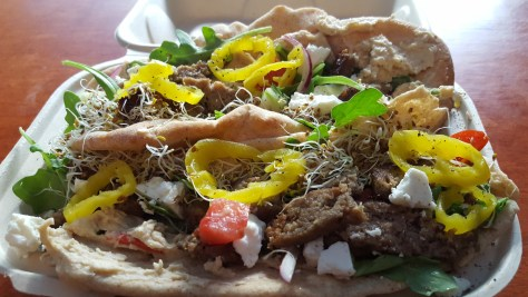Bach Farm ground lamb shawarma sandwich on house pita bread with Windy Hill Goat Dairy feta cheese.