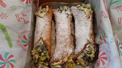 Sicilian-style Cannoli with pistachios and dark chocolate chips.
