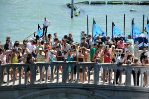 Sustainable tourism? Tourists on the Ponte della Paglia bridge, Venice.