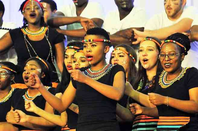 South Africa tourism minister raised racism at tourism month launch. Meanwhile, the many races of South Africa are represented in the Nelson Mandela University Choir. Source: GovernmentZA https://www.flickr.com/photos/governmentza/35872724332/