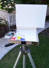"""Binder clips hold on the canvas panel and tea canister and Altoid tin """"side-cars."""""""
