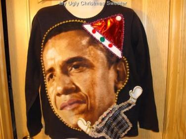President Obama wearing a santa cap Christmas sweater