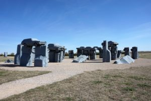 Old vehicles stacked to look like Stonehenge