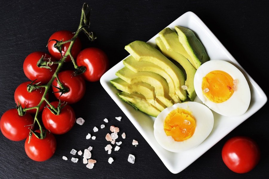 Hard Boiled eggs, sliced avocado, and cherry tomatoes