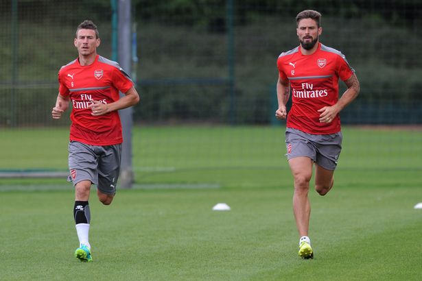 L-R-Laurent-Koscielny-and-Olivier-Giroud-of-Arsenal-during-a-training-session
