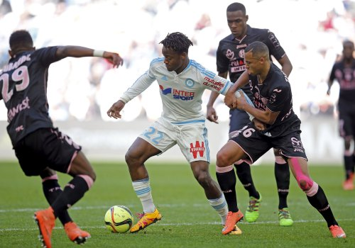 Football Soccer - Olympique Marseille v Toulouse  - French Ligue 1 - Velodrome stadium , Marseille, France - 6/3/2016  Olympique Marseille's Michy Batshuayi (C) in action against Toulouse's Marcel Tisserand (R).  REUTERS/Jean-Paul Pelissier  Picture Supplied by Action Images