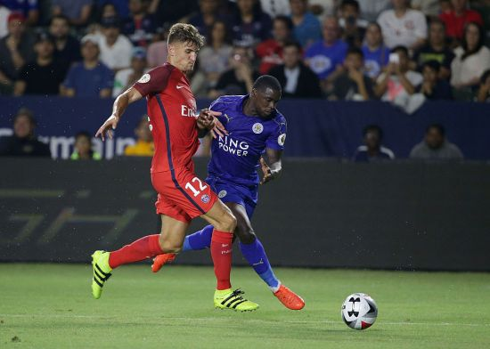 CARSON, CA - JULY 30: Jeff Schlupp #15 of Leicester City is pursued by Thomas Meunier #12 of Paris Saint-Germain during the 2016 International Champions Cup at StubHub Center on July 30, 2016 in Carson, California. (Photo by Jeff Gross/Getty Images)