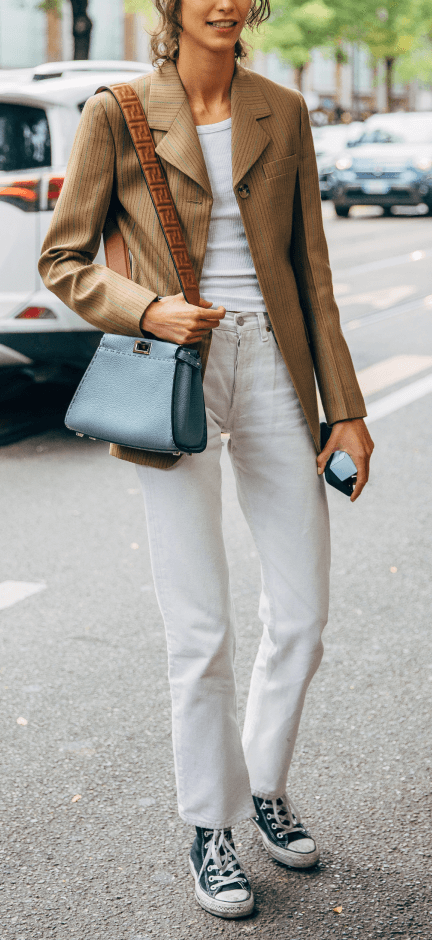 Woman wearing Mother White Jeans