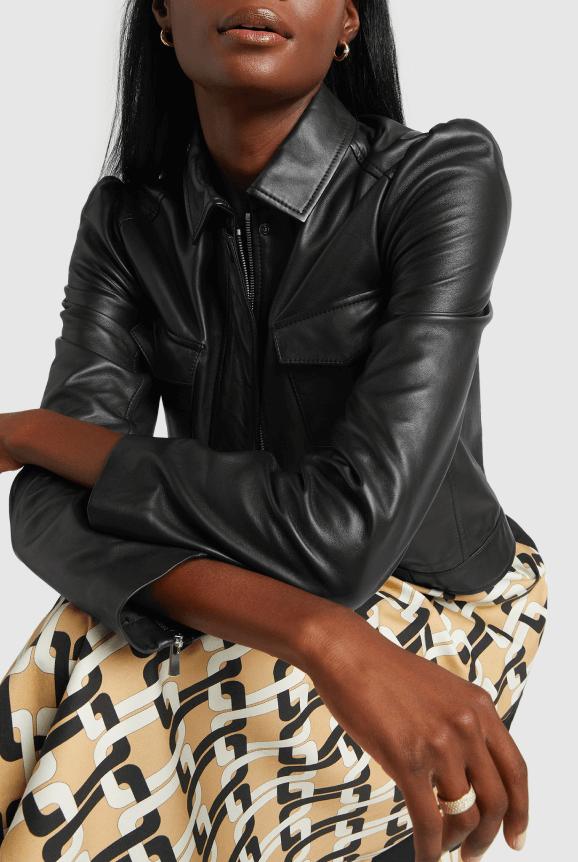 model wearing leather sleeve jacket