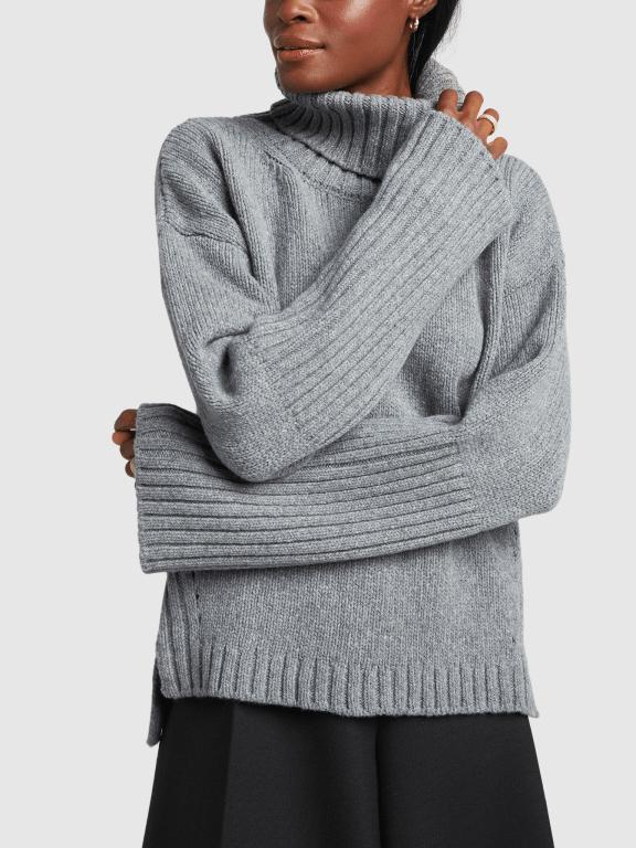 model wearing turtleneck sweater