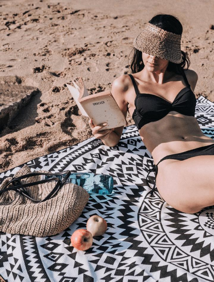 Model reading on the beach