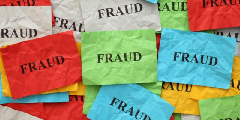 wrinkled pieces of colored paper with the word fraud typed on them