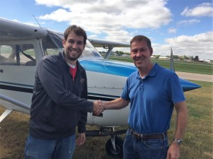 CFI Mark Jaeger congratulating his student and new private pilot Tim Silver