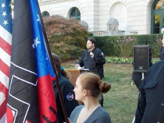 A neo-Nazi speaks at the rally on the grounds of Old City Hall.
