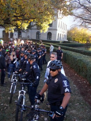 Police prepare to escort neo-Nazi and KKK protesters from Old City Hall.