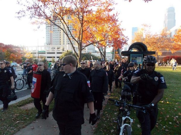 Neo-Nazis and KKK members are escorted by police from Old City Hall.