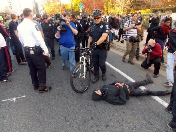 Counter-protesters attempt to block police as they escort neo-Nazi and KKK members.