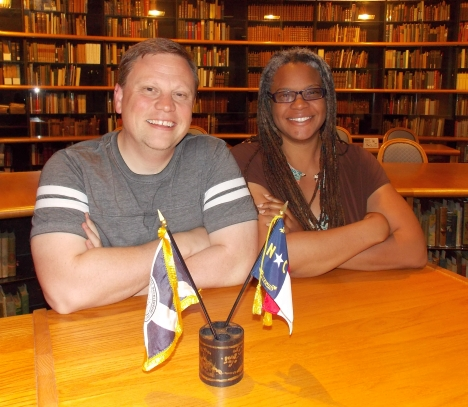 UNCC staffers Joshua Burford and Meredith Evans, pictured here int he reading room of the UNC-Charlotte Archives, want to collect and preserve local LGBT history. File Photo.