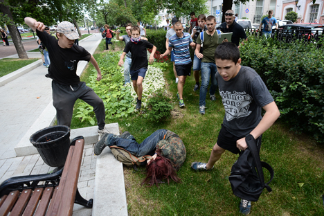"An LGBT activist is attacked following a ""Day of Kisses"" protest against Russia's anti-propaganda law in front of the State Duma in Moscow on June 11, 2013. Photo Credit: Roma Yandolin, via Flickr. Licensed CC."