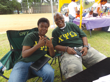 Samantha Mercer (left) and Nel Dixon were happy to represent their Chi Psi Omega Fraternity at Charlotte Black Gay Pride. File Photo