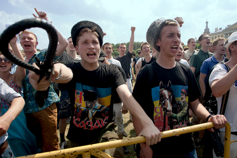 Far-right nationalists counter-protested and instigated violent attacks against gay rights activists in St. Petersburg on June 29, 2013. Here, one holds a bullwhip as he taunts the activists. Photo Credit: Valentine Egorshin. Republished with permission.