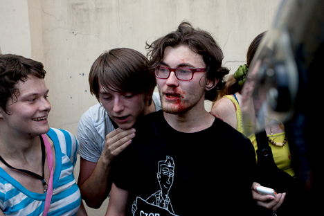 An LGBT activist in St. Petersburg is consoled by friends after being hit during the city's Pride march protest on June 29, 2013. Photo Credit: Valentine Egorshin.