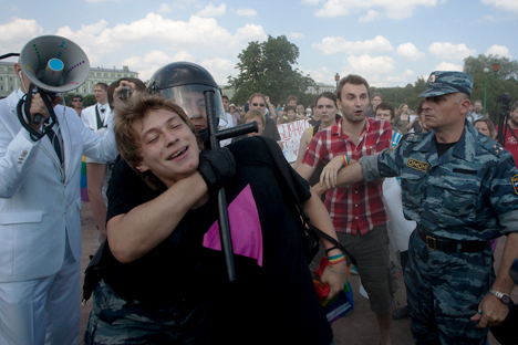 An LGBT activist is arrested after an altercation with an anti-gay protester during the St. Petersburg LGBT Pride march on June 29, 2013. Photo Credit: Valentine Egorshin.