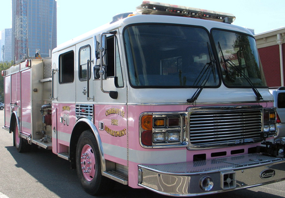"""On Tuesday, Sept. 27, 2011, the Charlotte Fire Department unveiled """"The Pink Lady,"""" a reserve engine repainted pink just in time for the many events that promote breast cancer awareness. Breast cancer has touched the lives of many within the Charlotte community as well as members of the Charlotte Fire Department. The department says the truck is a way of showing solidarity and support for all those who have either directly or indirectly been affected by the disease. """"The Pink Lady"""" made its official debut at the Susan G. Komen Race for the Cure on Oct. 1, 2011, and can still be seen at many events throughout the city.  Photo Credit: Charlotte Fire Department"""