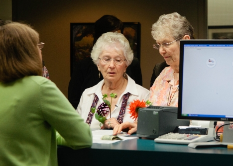 Carole Kaiser, left, and Mary Burson, with Henderson County Register of Deeds Nedra Moles, foreground. Photo Credit: Campaign for Southern Equality.