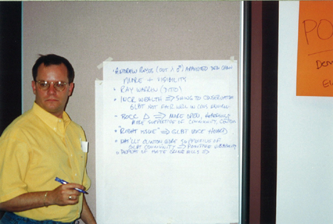 Longtime community leader John Quillin leads a discussion in this undated photograph from a community center planning meeting.